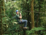 zip lining smiling in rainforest