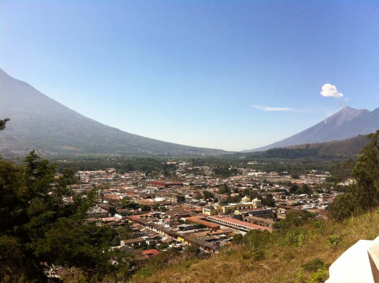 Antigua, Guatemala with active volcano in background