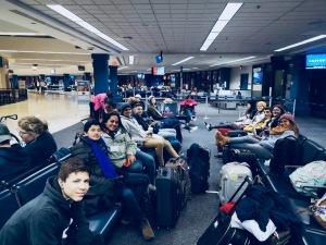 students sleeping at airport